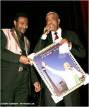 Girma presenting Mahmoud with Toronto poster (my photo from his 2007 show)